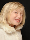 Smiling blond girl Stock Image