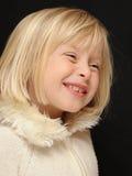 Smiling blond girl Stock Image