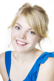 Smiling blond girl in blue Stock Images
