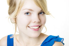 Smiling blond girl in blue Royalty Free Stock Photos