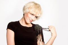 Smiling blond girl isolated over light bg Stock Photos
