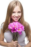 Smiling Blond Girl with Pink Flowers Stock Images