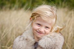 Smiling blond girl portrait Royalty Free Stock Images