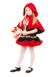 Smiling blond girl. Posing in a dress of little red riding hood. Isolated on white Royalty Free Stock Photo