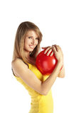 Smiling blond girl with red ball Stock Photos