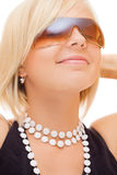 Smiling blond girl in sun glasses Stock Image