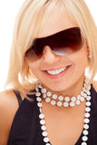 Smiling blond girl in sun glasses Royalty Free Stock Images