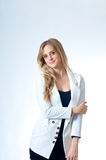 Smiling Blond Girl In White Jacket Stock Images