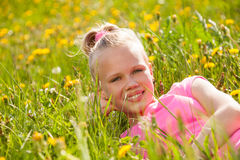 Smiling blond girl in yellow flowers portrait Royalty Free Stock Image