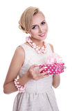 Smiling blond hair woman holding gift box with ribbon Royalty Free Stock Photos
