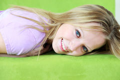 Smiling blond haired teenager royalty free stock image