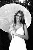Smiling Blond lady holding umbrella Royalty Free Stock Image
