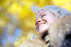 Smiling blond looks into the distance Royalty Free Stock Image