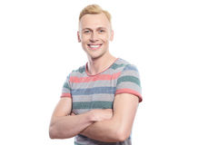 Smiling blond man with crossed arms Royalty Free Stock Photography