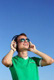 Smiling blond with nice headphones glasses Royalty Free Stock Photos