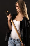 Smiling blond teenager with ax in hands Stock Photos