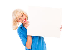 Smiling blond woman with blank white card. Royalty Free Stock Photo