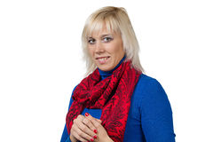 Smiling blond woman in blue Royalty Free Stock Image