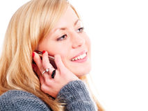 Smiling blond woman calling by phone Royalty Free Stock Image
