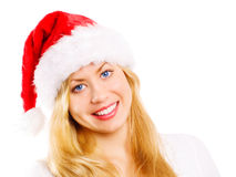 Smiling blond woman in christmas cap over white. Closeup of smiling blond woman in christmas cap over white background Stock Images