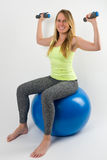 Smiling blond woman doing exercises with dumbbells Royalty Free Stock Image