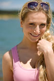 Smiling blond woman enjoy summer sun Stock Photo