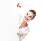 Smiling blond woman holding signboard. Isolated over white background Stock Photos