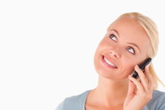 Smiling blond woman on the phone Stock Photography