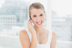 Smiling blond woman on the phone Royalty Free Stock Image