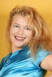 Smiling blond woman portrait Stock Images