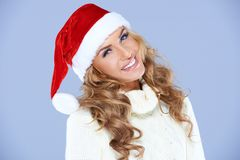Smiling blond woman in Santa hat isolated Stock Image