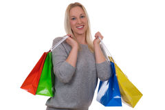 Smiling blond woman with shopping bags Royalty Free Stock Images