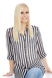 Smiling Blond Woman Wearing Striped Shirt. In Studio with White Background Stock Photos