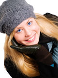 Smiling blond woman in winter clothes Royalty Free Stock Image