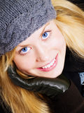 Smiling blond woman in winter clothes Stock Photography