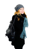 Smiling blond woman in winter clothes holding bag. Over white Royalty Free Stock Images