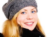 Smiling blond woman in winter clothes o Royalty Free Stock Image
