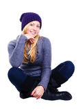 Smiling blond woman in winter clothes over white Stock Photos