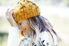 Smiling blond woman in winter outfit Royalty Free Stock Image