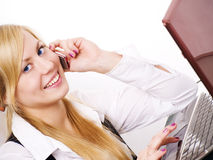 Smiling blond woman working calling by phone in of Royalty Free Stock Image