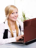 Smiling blond woman working with computer Stock Images