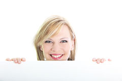 Smiling blonde behind white board Stock Image