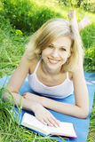 Smiling blonde with a book Stock Photos