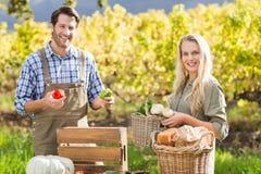 Smiling blonde customer buying vegetables Stock Photos