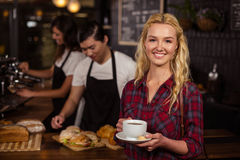 Smiling blonde customer in front of the counter Royalty Free Stock Photo