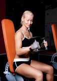 Smiling blonde doing exercise Royalty Free Stock Photo