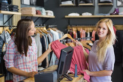 Smiling blonde doing shopping and looking at camera Royalty Free Stock Images