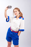 Smiling blonde female sailor with camera Royalty Free Stock Images