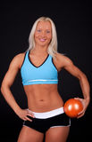 Smiling blonde with fitness ball Royalty Free Stock Image