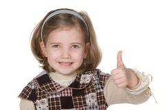 Smiling blonde girl holding her thumb up Stock Image